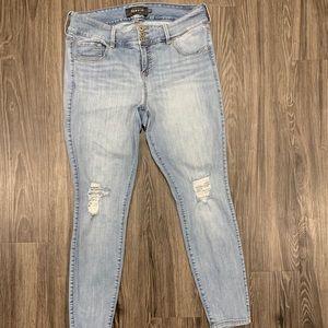 Torrid skinny leg jeans with distressed knees